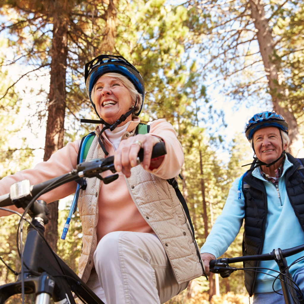 Photo of senior couple mountain biking